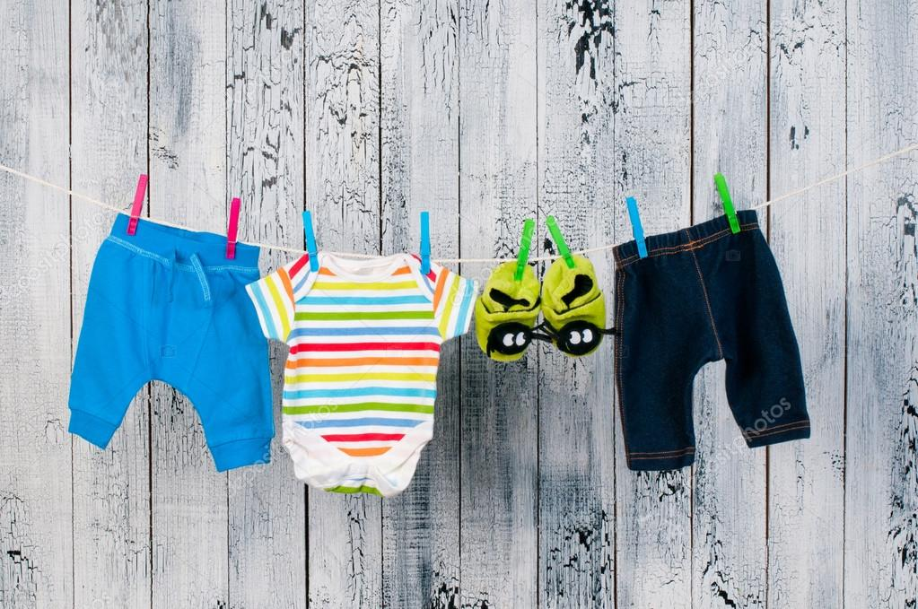depositphotos_23745125-stock-photo-baby-clothes-hanging-on-the